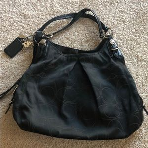 Authentic Coach hobo style purse w/purple lining